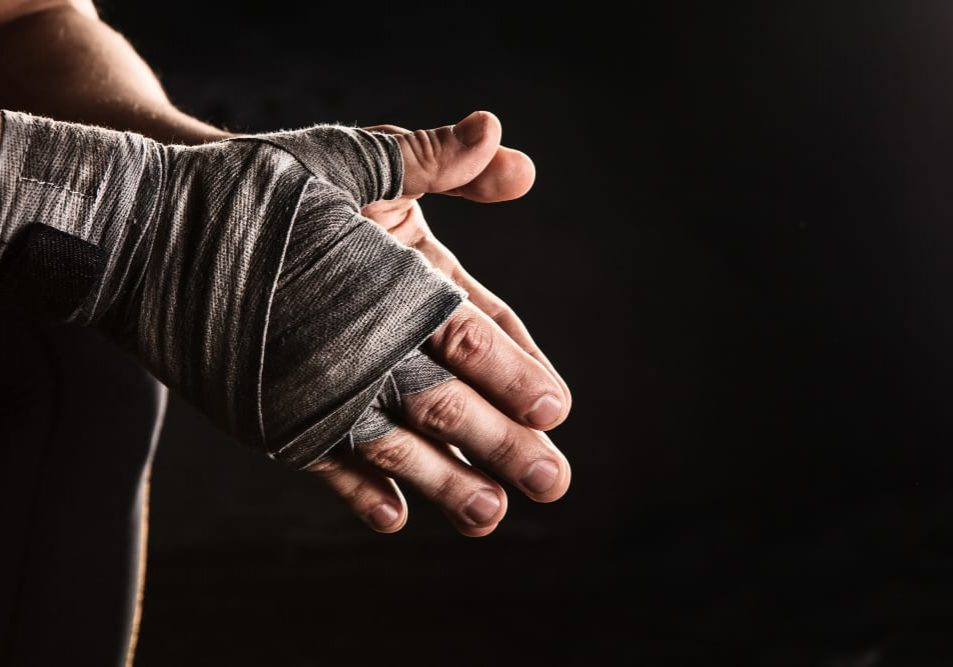 close-up-hand-muscular-man-with-bandage